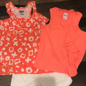 Two coral tank tops with white lace shorts